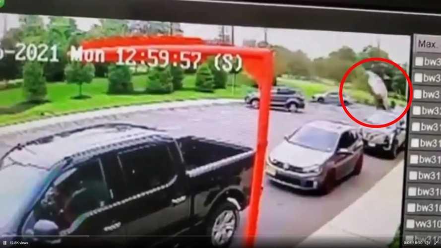 Video captures car jumping berm, crashing into fast-food restaurant
