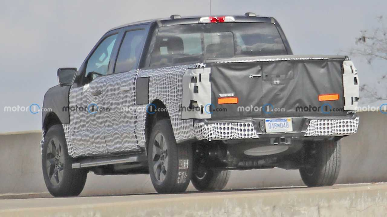 A rear view of the upcoming all-electric Ford F-150 showing its motor at the rear wheels.