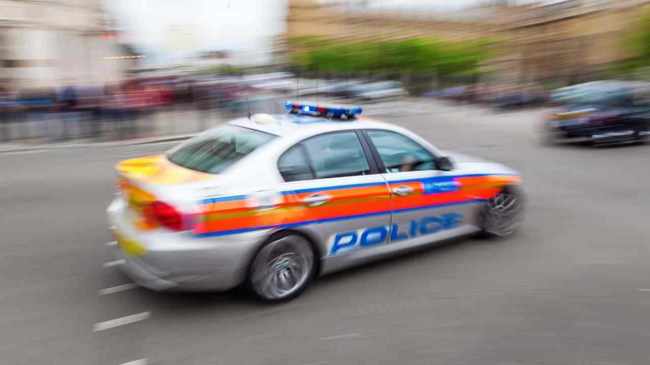 Police car in London in motion