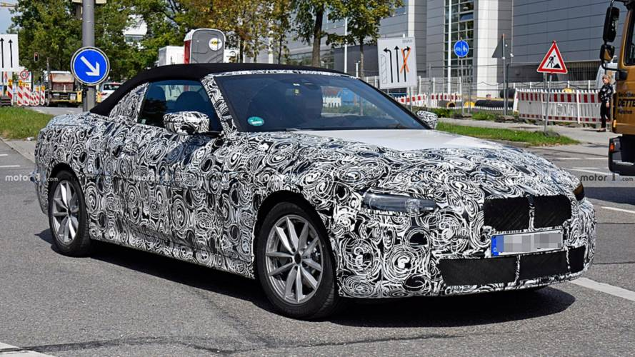 BMW 4 Series Convertible spied on the road, showing its soft top