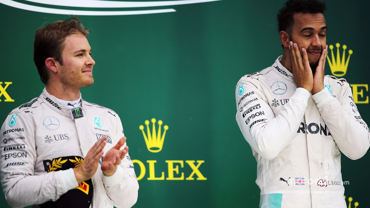 The podium (L to R): second placed Nico Rosberg, Mercedes AMG F1 with team mate and race winner Lewis Hamilton, Mercedes AMG F1
