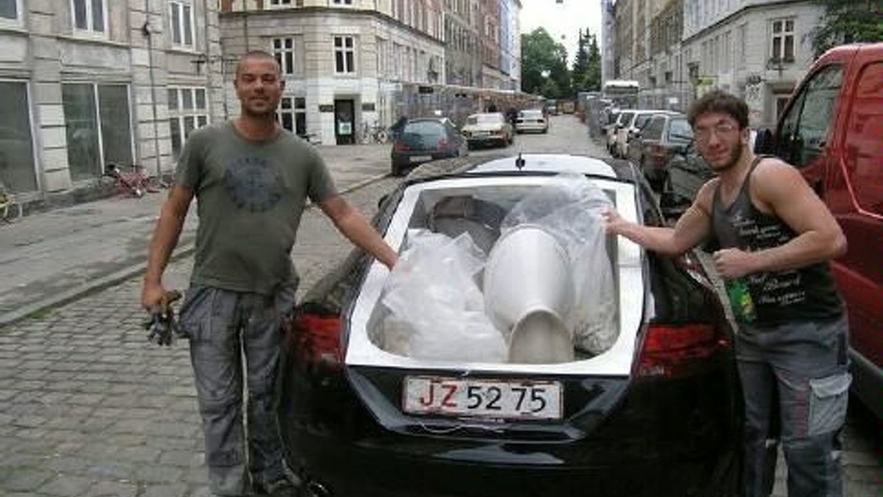 Comfortably seats two with room in the back for a body wrapped in plastic.