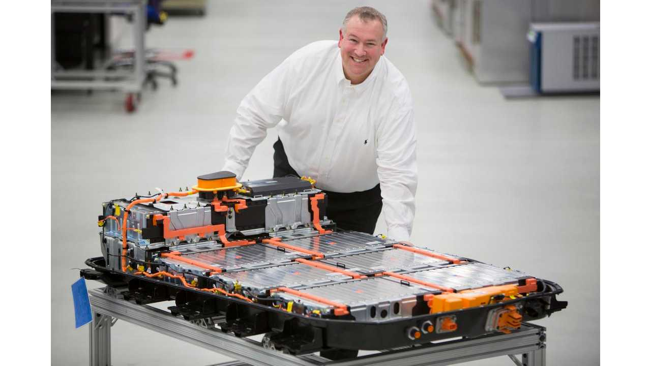 Greg Smith, Engineering Group Manager, Electrification, with a Chevrolet Bolt EV battery pack in General Motors Global Battery Systems Laboratory at the GM Technical Center in Warren, Michigan, Tuesday, April 5, 2016. (Photo by Jeffrey Sauger for General Motors)