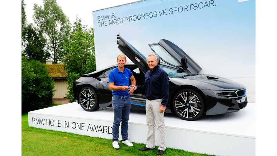 Golfer Wins BMW i8 With Hole In One