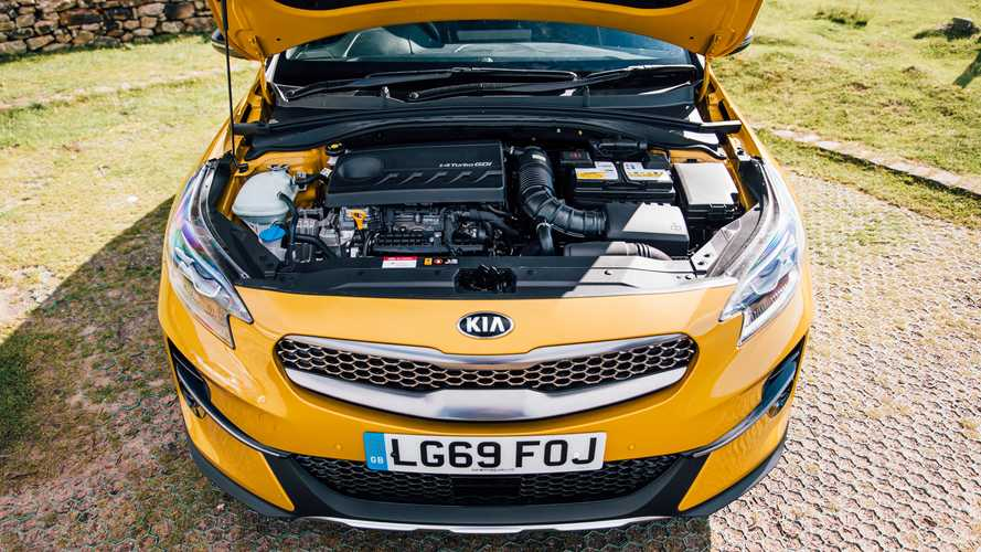 Kia XCeed logo with open bonnet showing engine