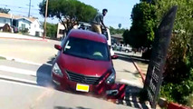 Owner of Nissan Altima tries to free his car