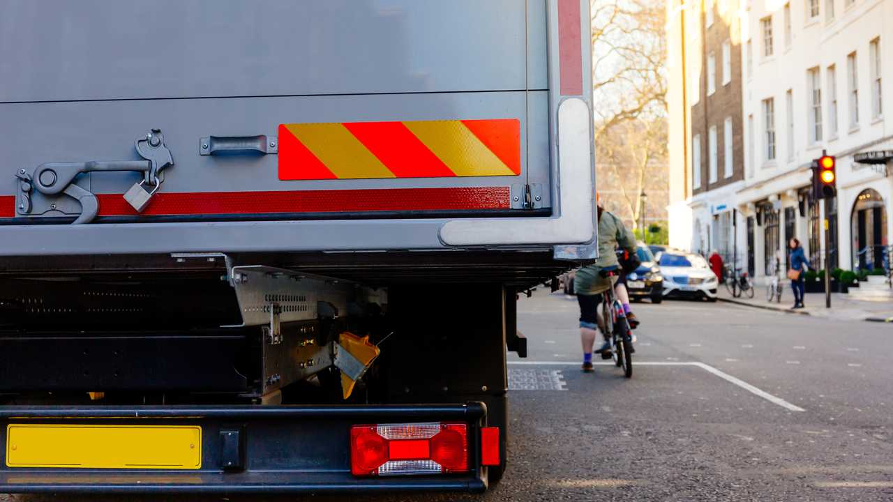 HGV and bicyclist share the road in London