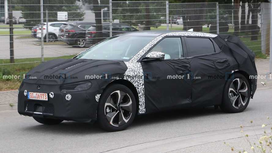 Swoopy Kia Electric SUV spied with heavy camouflage