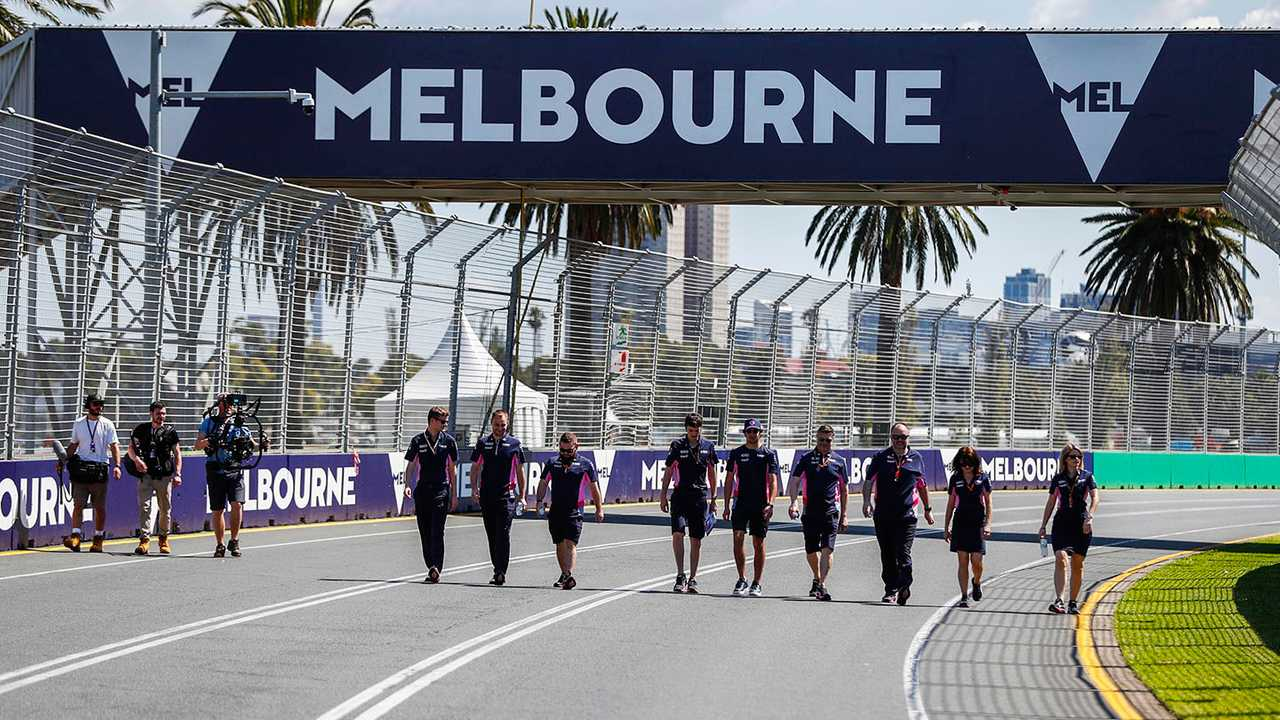 Lance Stroll, Racing Point walks the track with members of the team
