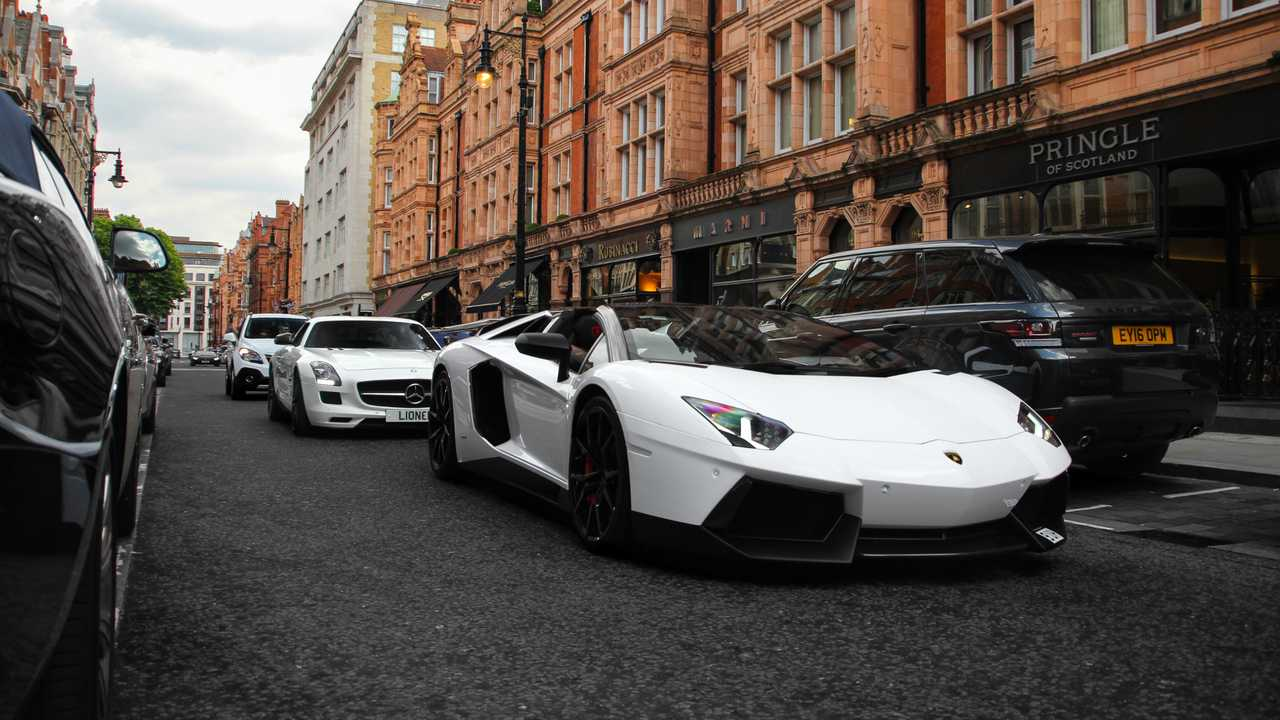 Lamborghini Aventador, Mercedes SLS AMG cruising down the streets of Mayfair