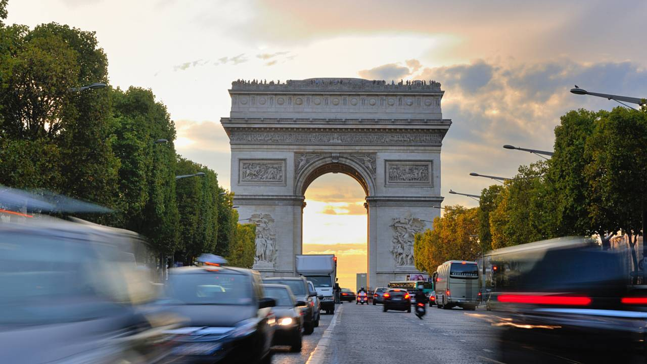 Car traffic at Arc de Triomphe Paris France