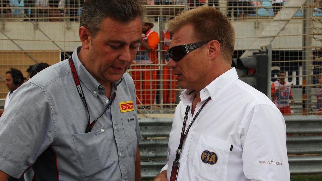 Mario Isola Pirelli Racing Manager with Mika Salo 21.04.2013 Bahrain Grand Prix