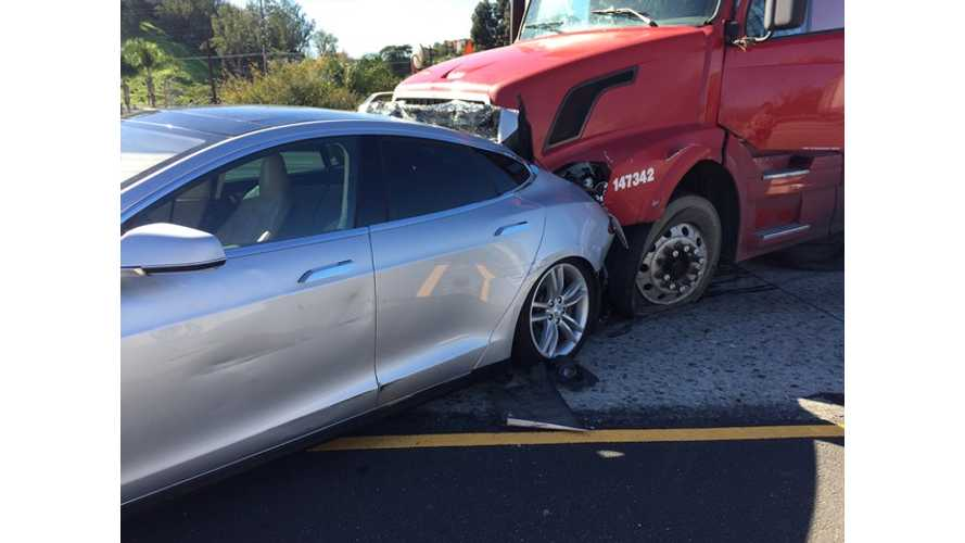 Driver Walks Away Unharmed After Big Rig Rear Ends Tesla Model S