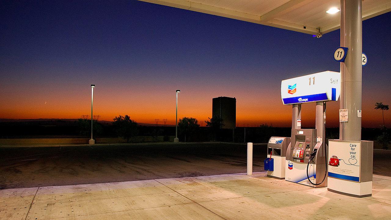 gas station pump at sunset