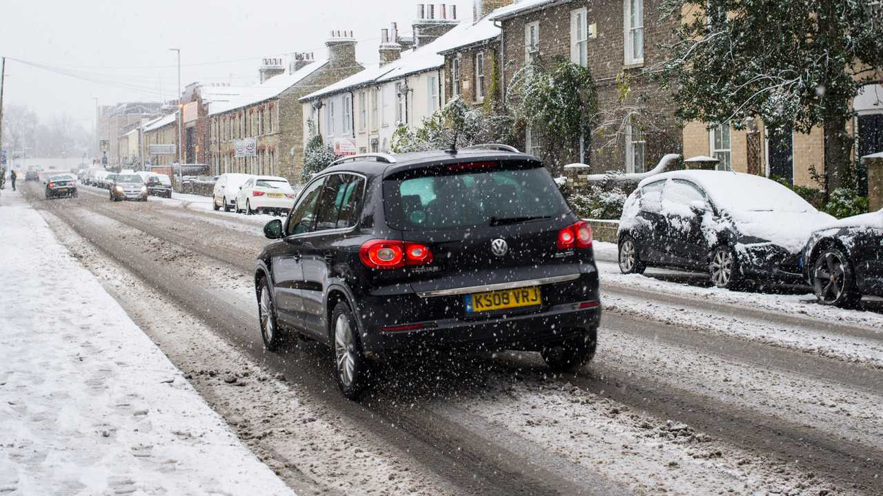 Car driving on snow covered road in Cambridge England