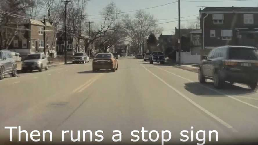 Watch Reckless Toyota Drive Into Oncoming Traffic, Blow Stop Sign