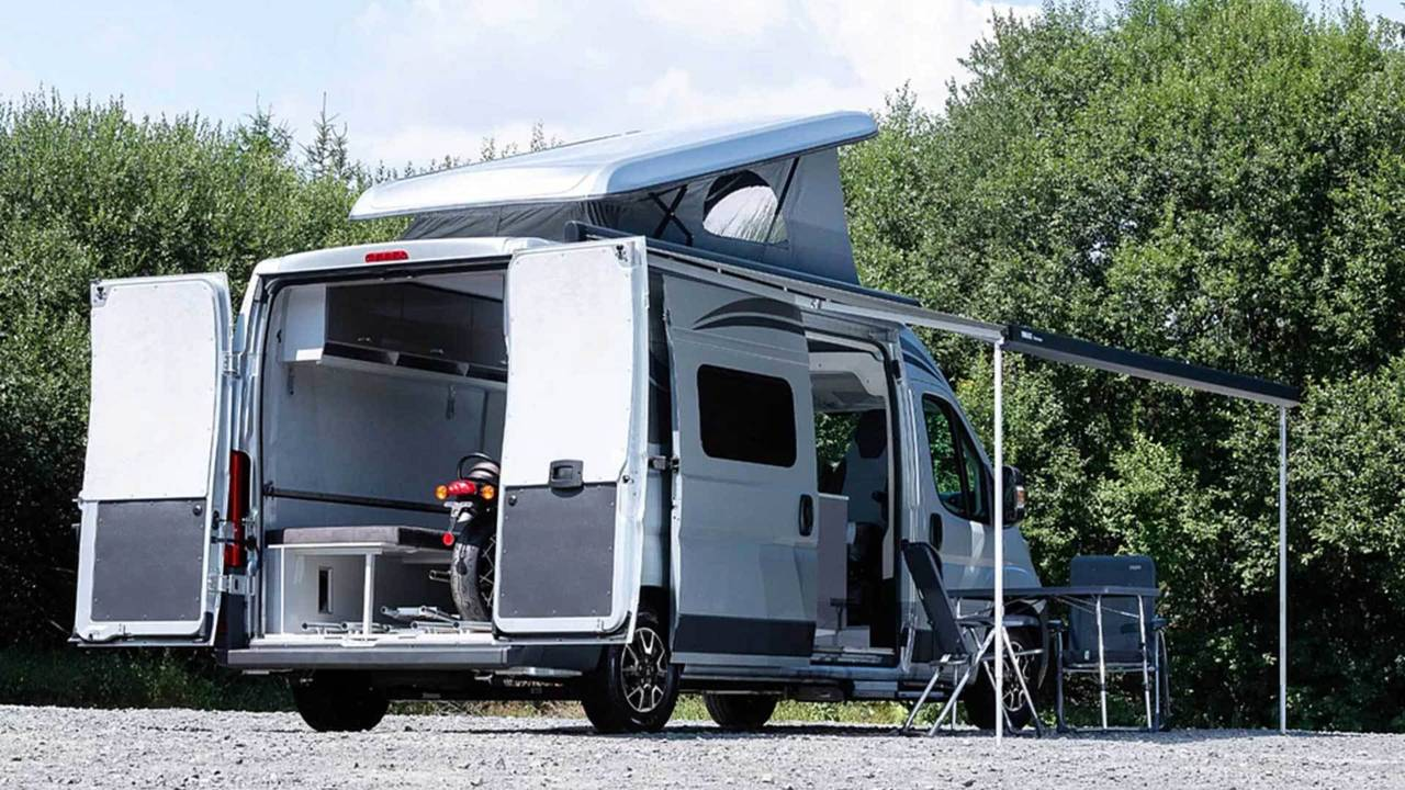 The pop-top and side awning make for a pretty spacious and versatile vehicle.