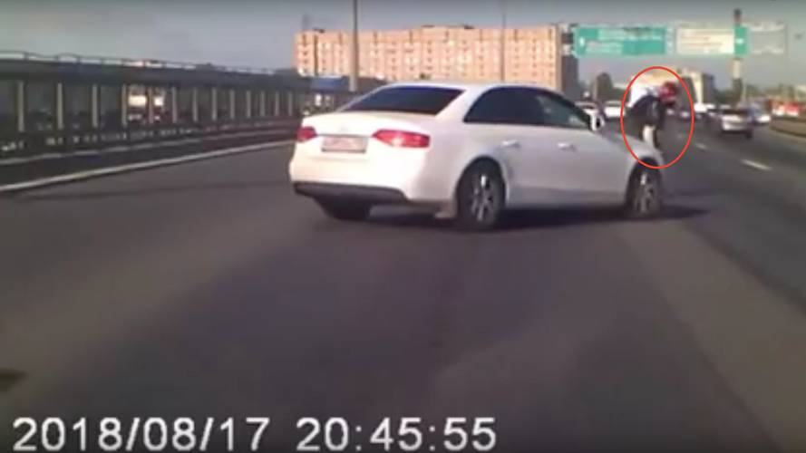 Driver Shields Fallen Motorcyclist From Oncoming Traffic