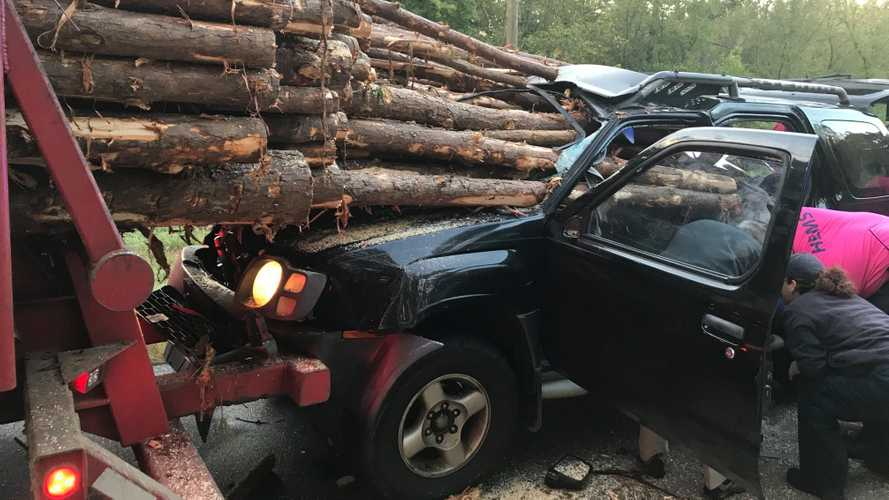 Nissan Xterra impaled by logs