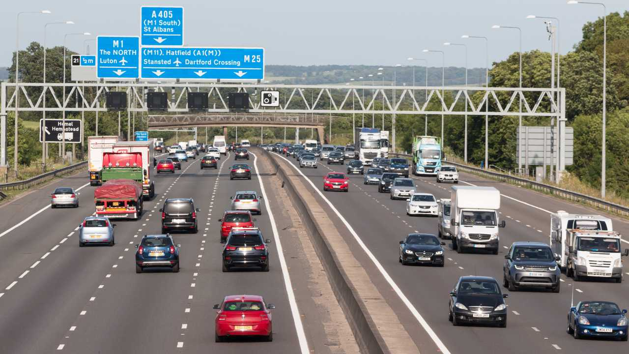 Evening traffic on the busiest British motorway M25 in London UK
