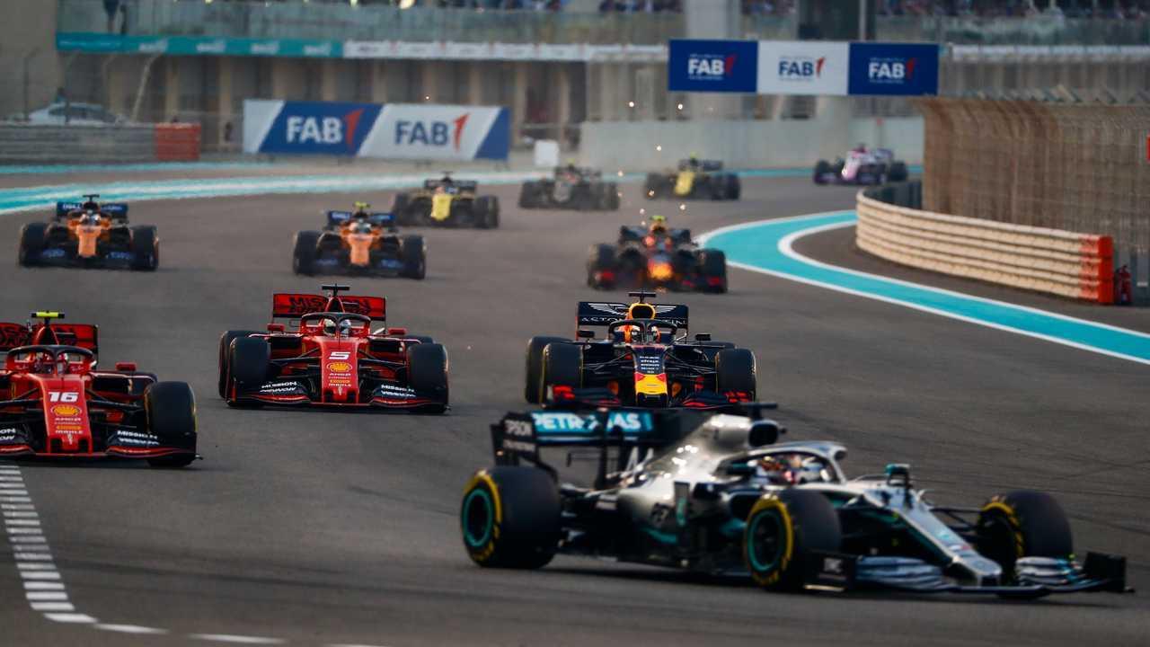 Lewis Hamilton, Mercedes AMG F1 W10, leads Charles Leclerc, Ferrari SF90, Sebastian Vettel, Ferrari SF90, Max Verstappen, Red Bull Racing RB15, and the rest of the field on the opening lap