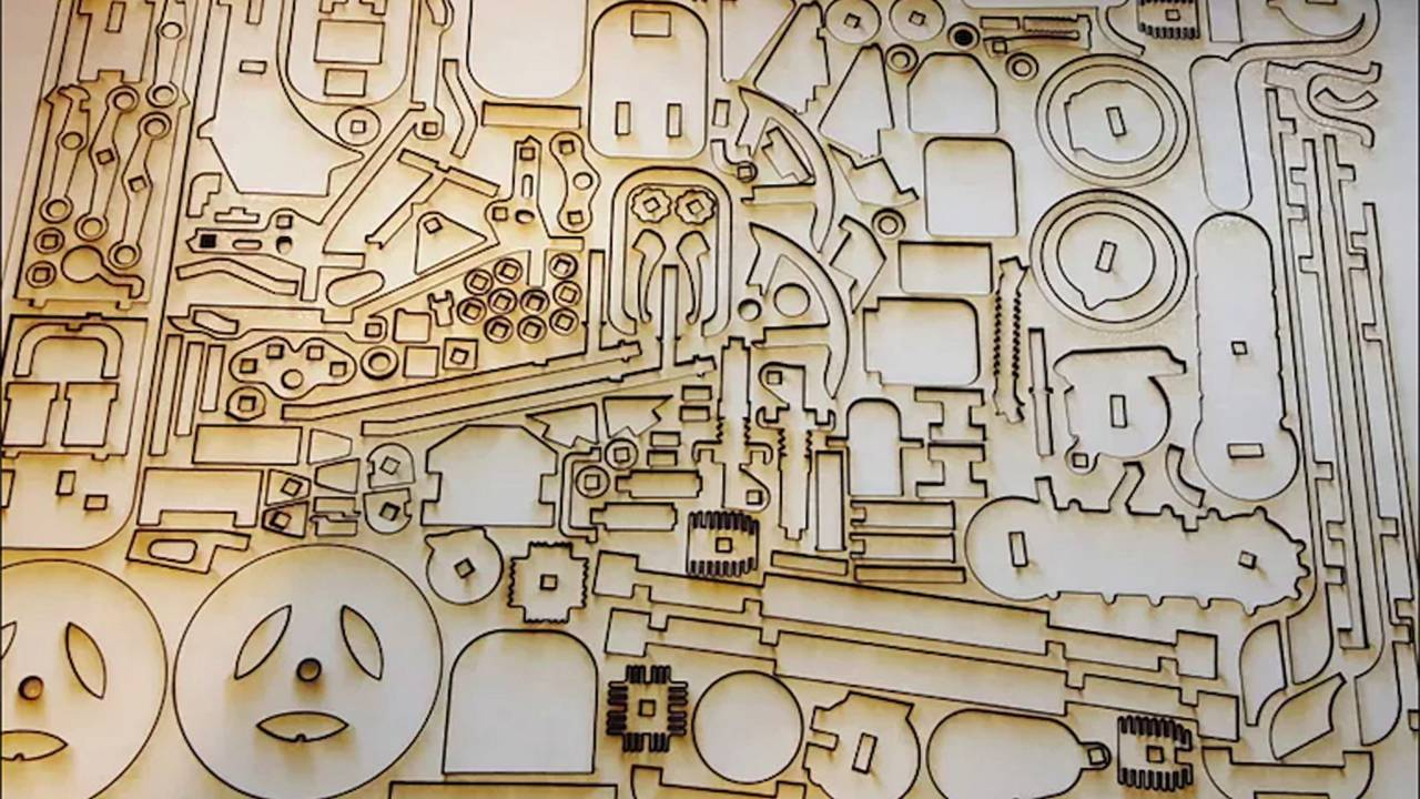 Some of the 180 laser-cut pieces that make up the Lasercompo set