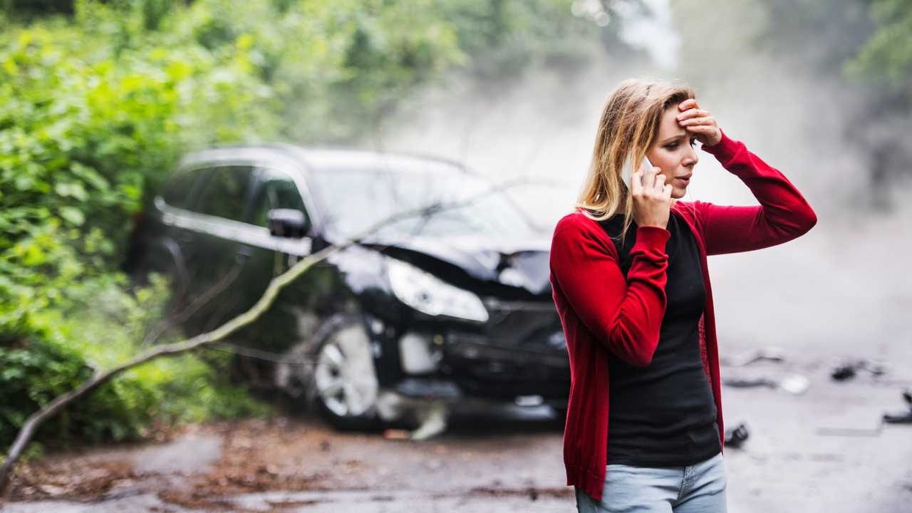 Woman after a car accident making a phone call