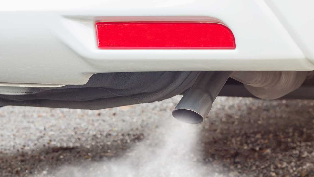 Exhaust fumes from car exhaust pipe