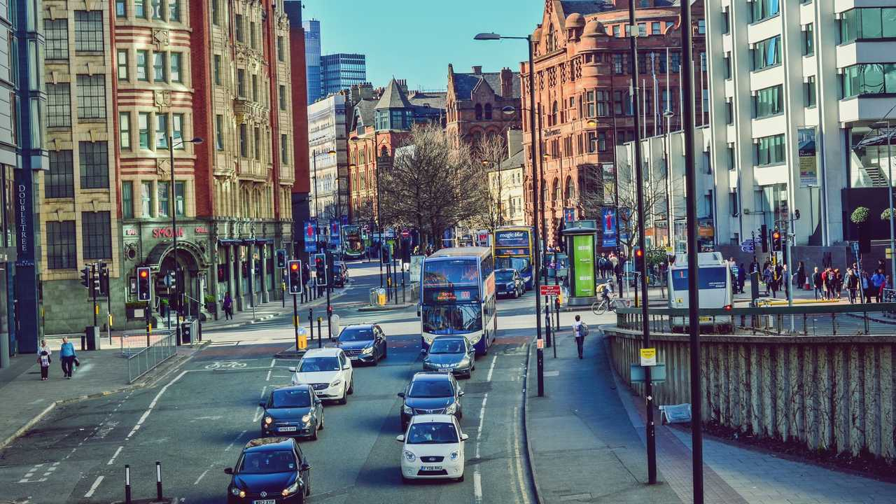 Heavy traffic during rush hour in Manchester city center UK