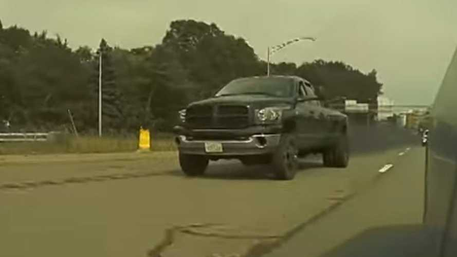 Watch This Coal-Rolling Ram Go Crazy When A Tesla Is Spotted