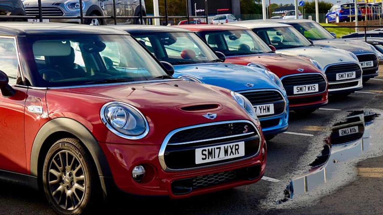 New Mini Coopers on dealership forecourt Edinburgh Scotland UK