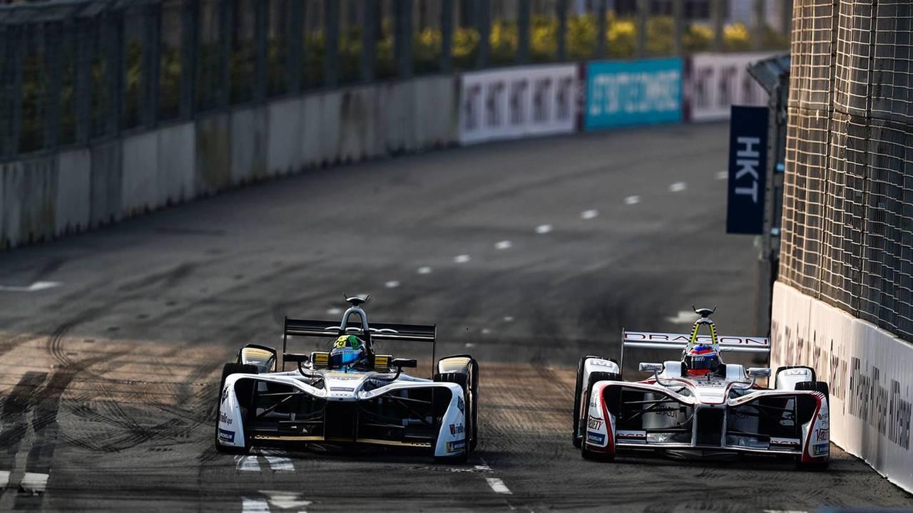 Lucas di Grassi, Audi Sport ABT Schaeffler, leads Neel Jani, Dragon Racing