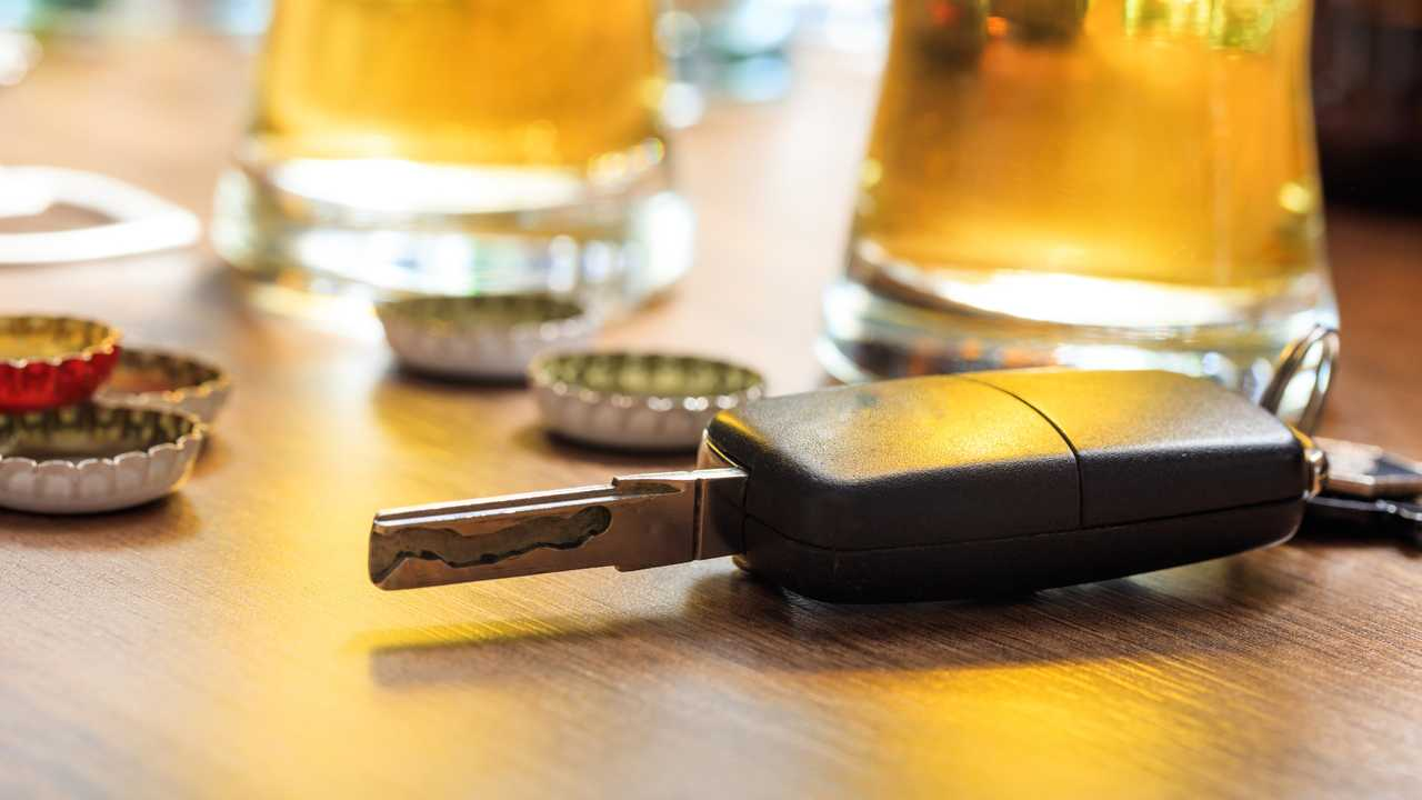 Car key on a wooden table in a pub