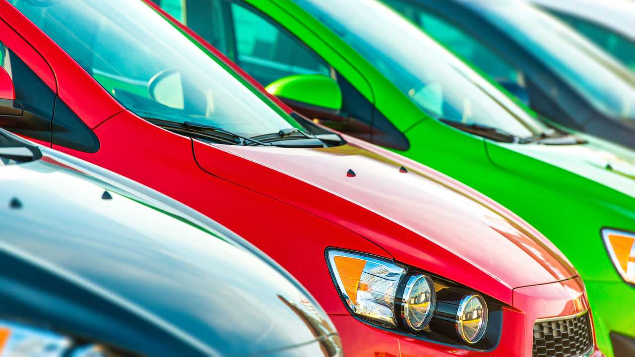 Colourful cars lined up in dealer forecourt