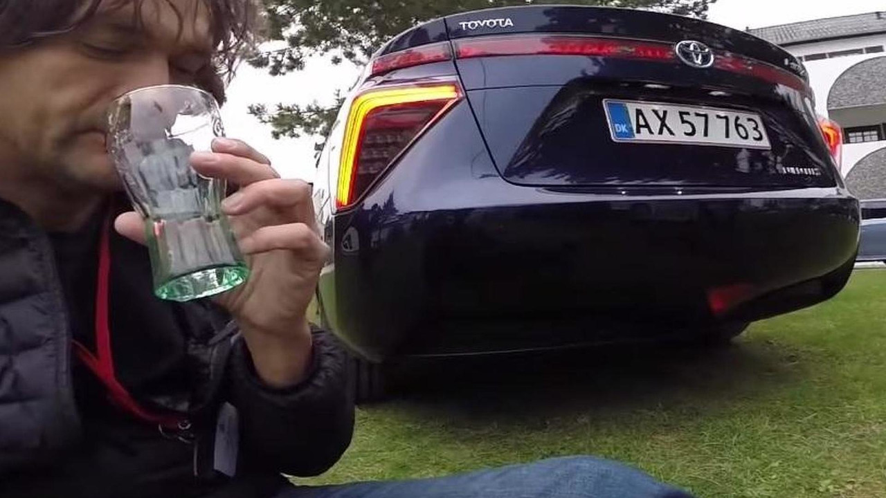 A journalist drinking water from the Toyota Mirai