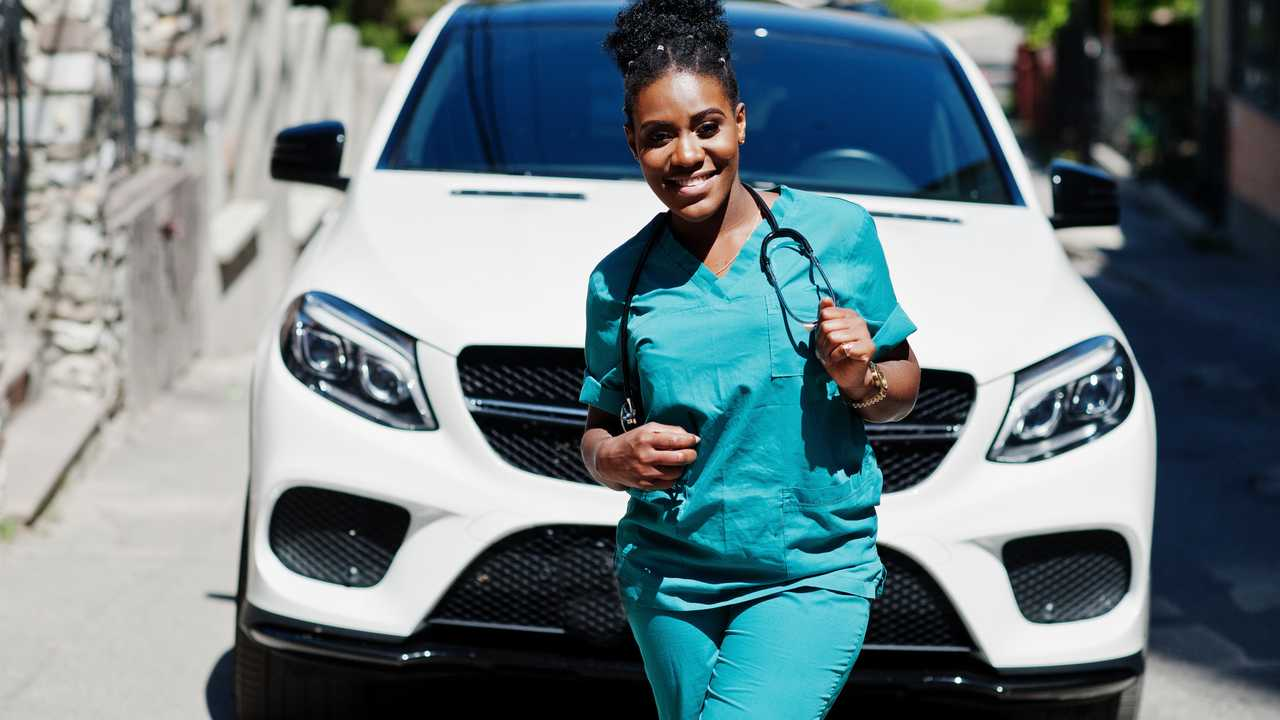 Woman doctor with white suv